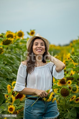 beautiful girl in field of sunflowers