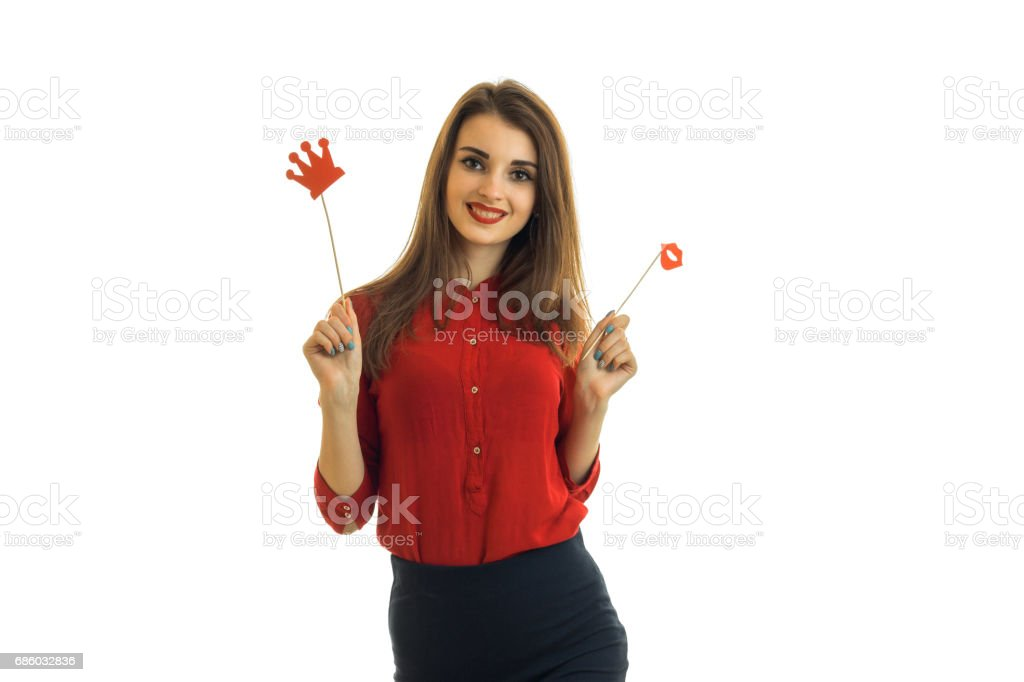beautiful girl in frenzy red blouse looks into the camera and holds the paper Dummies for photo stock photo