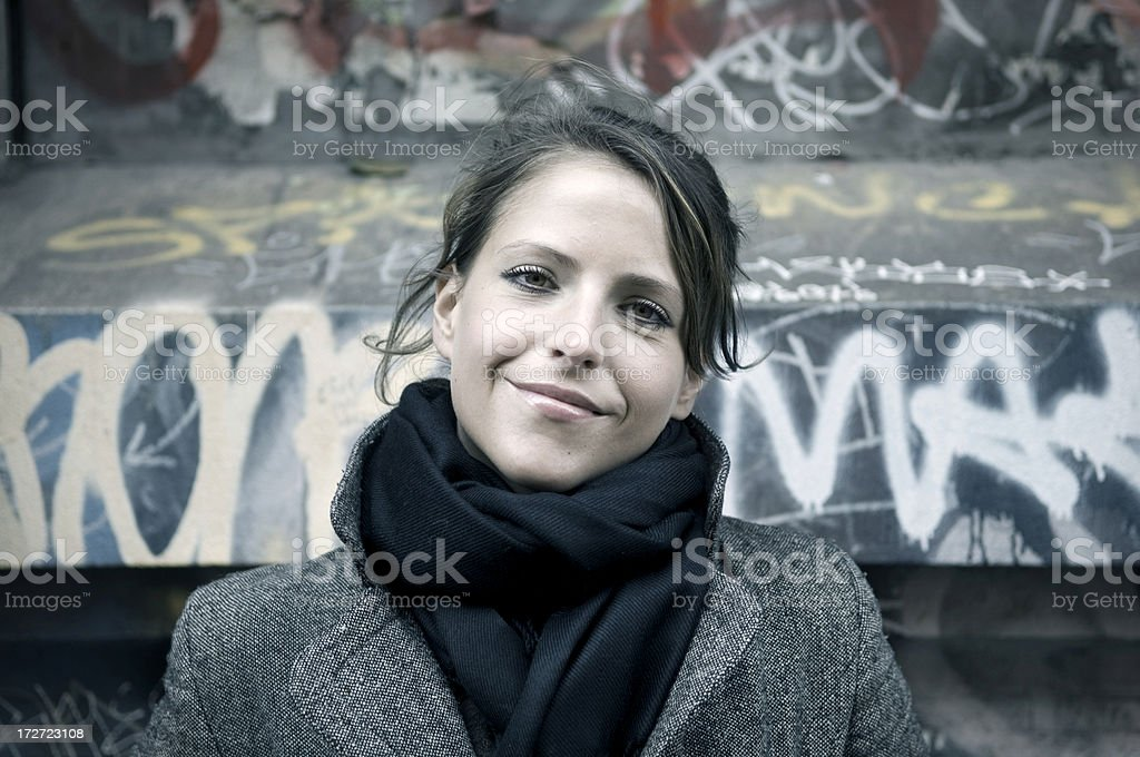 Beautiful girl in front of graffities royalty-free stock photo