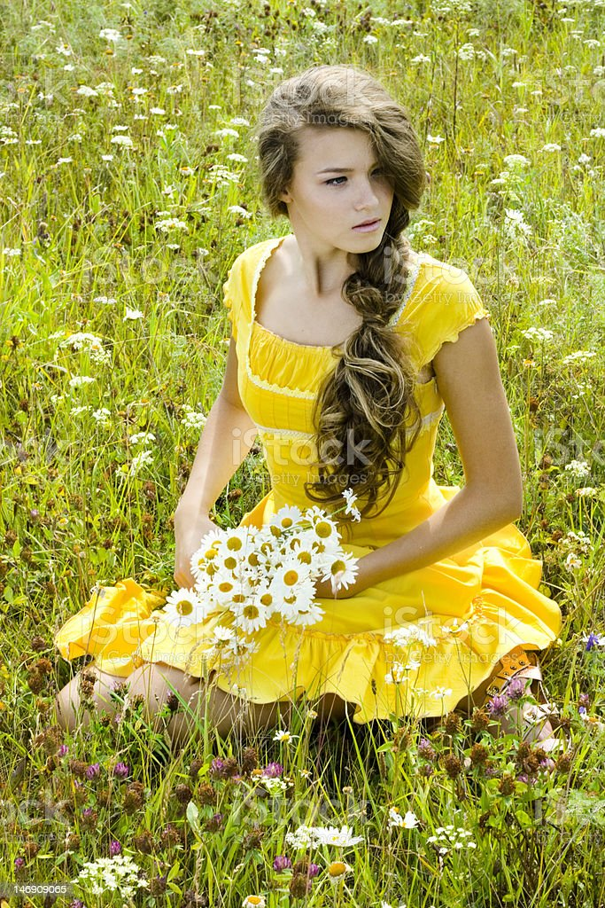Beautiful girl in green field royalty-free stock photo