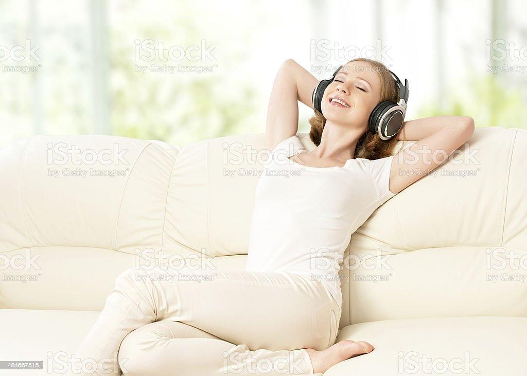 beautiful girl in headphones enjoying music at home royalty-free stock photo
