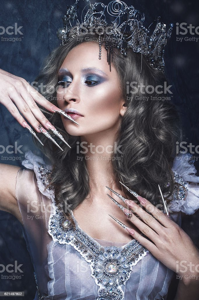 Beautiful girl in image of Snow Queen, creative make-up Lizenzfreies stock-foto
