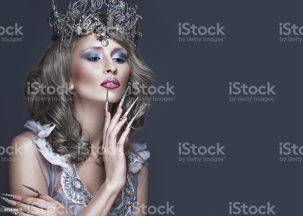 Beautiful girl in image of Snow Queen, creative make-up photo libre de droits