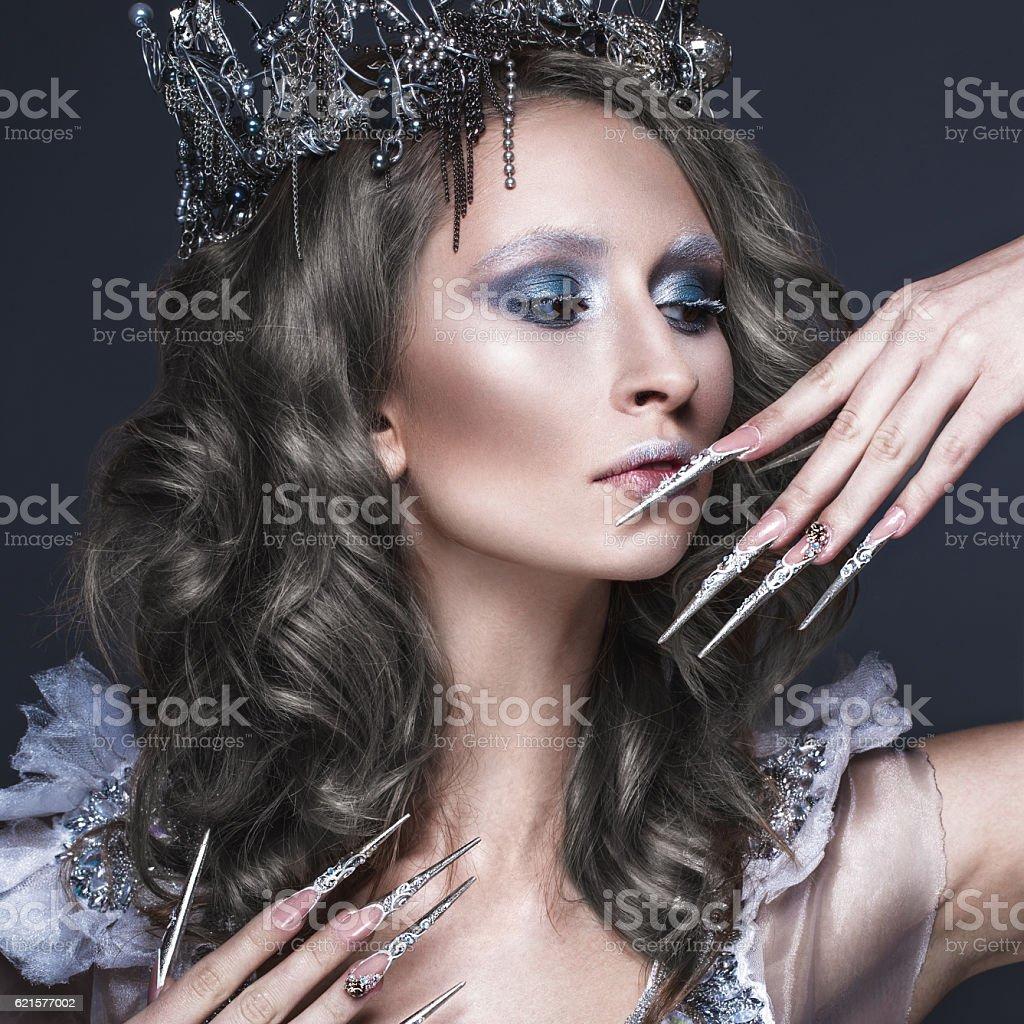 Beautiful girl in image of Snow Queen, creative make-up photo libre de droits