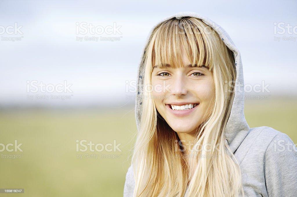 Beautiful girl in jacket with hood stock photo