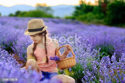 Happy young  girl in lavender field
