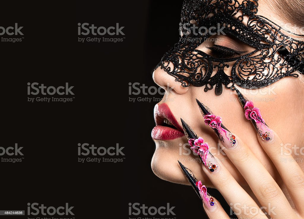 Beautiful girl in mask with long nails and sensual lips stock photo