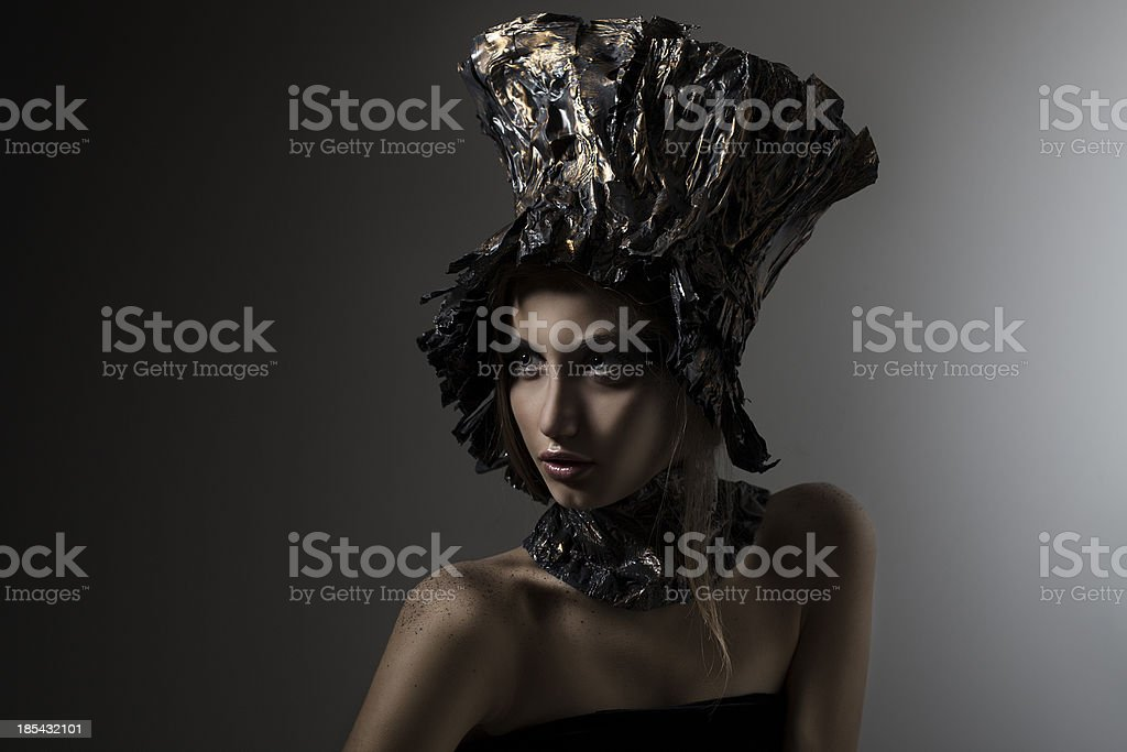 Beautiful girl in metal hat royalty-free stock photo
