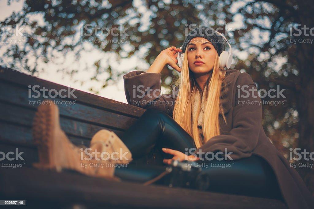 Beautiful girl in park stock photo