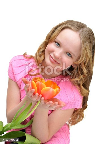 istock Beautiful girl in pink jacket with orange flower tulip. 514639564