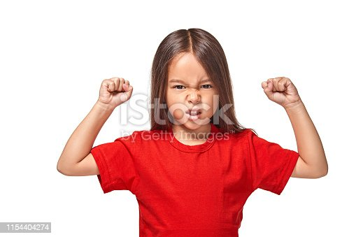 Beautiful girl in red t-shirt shakes her two fists in red t-shirt
