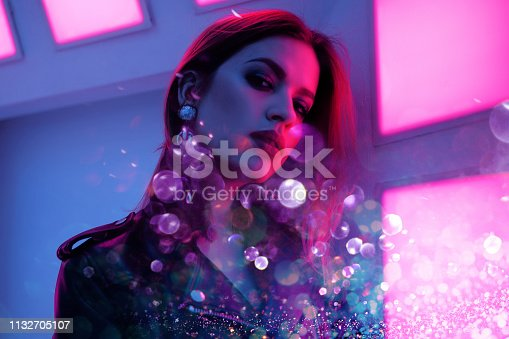 istock Beautiful girl in retro wave on the neon light. Portrait with double exposure effect 1132705107