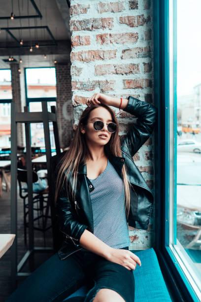 Beautiful Girl In Sunglasses Posing On Camera Stock Photo