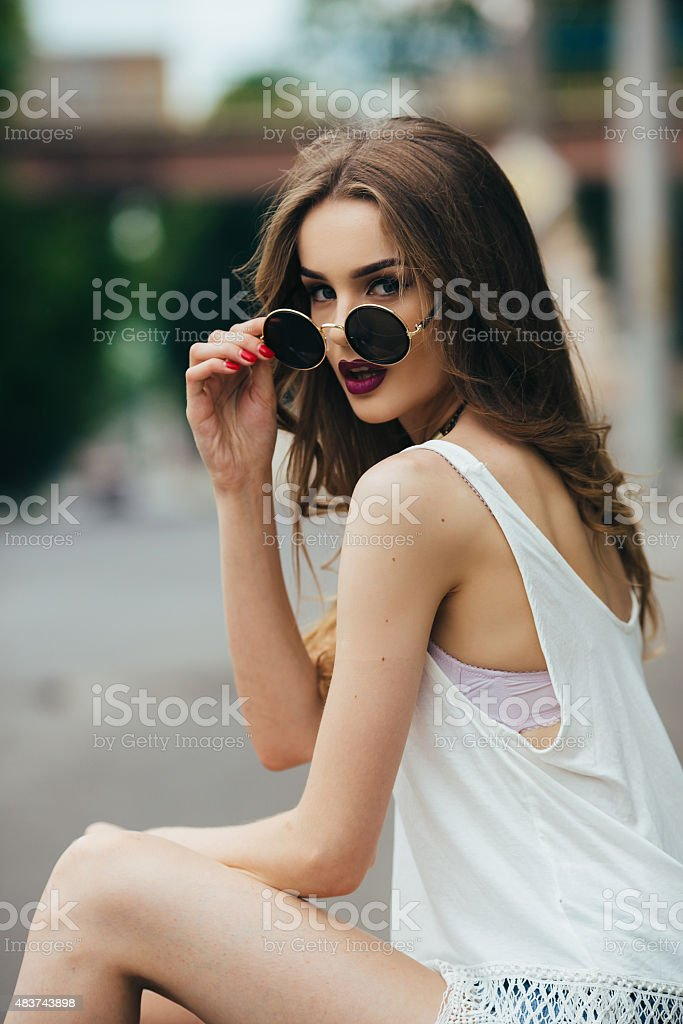 cc43adf43 Beautiful Girl In Sunglasses Sitting Stock Photo - Download Image ...