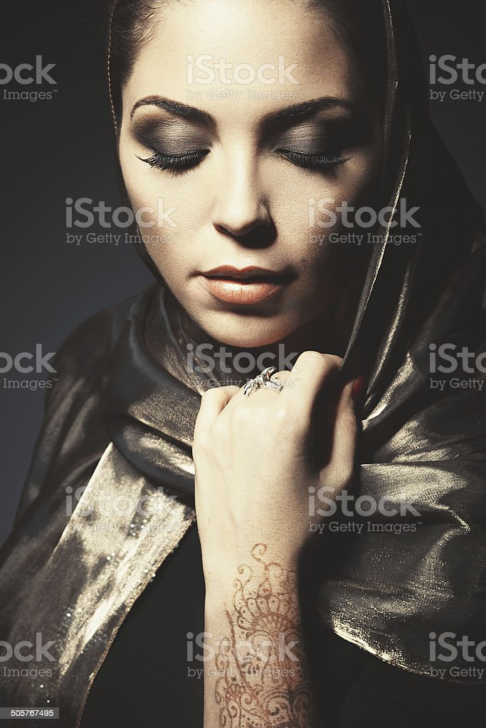 Beautiful girl in the Arab image with bright oriental make- stock photo