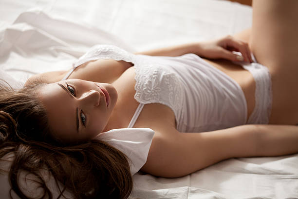 Beautiful girl in the bedroom stock photo