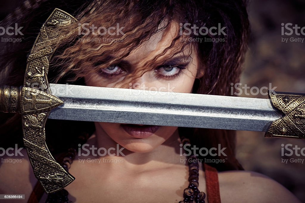 Beautiful girl in the clothes of a Viking or Amazon. stock photo