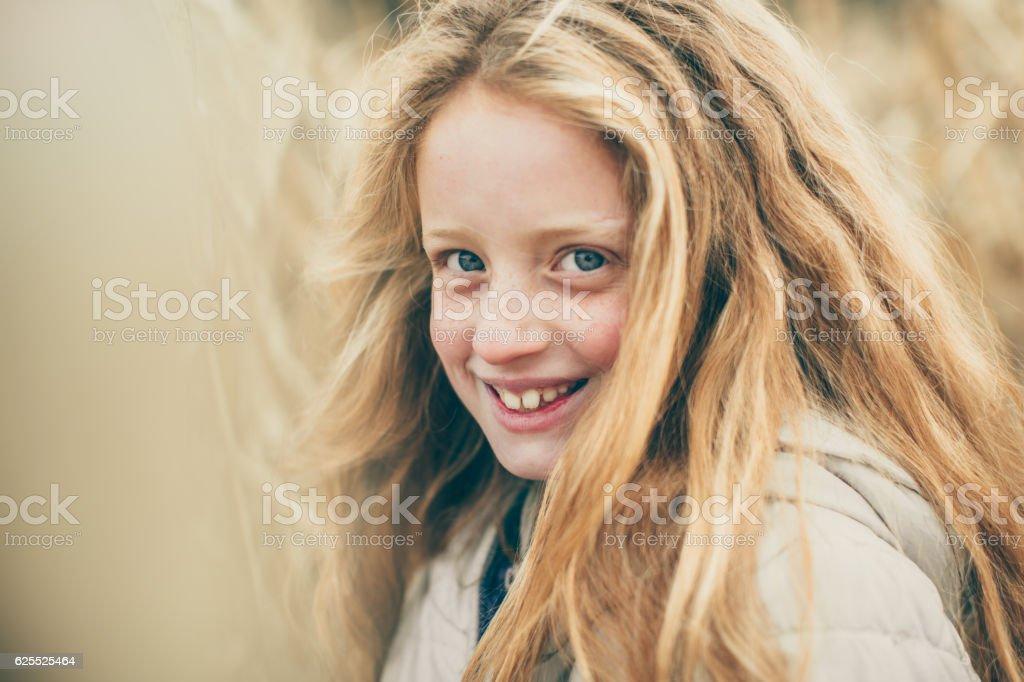 Beautiful girl in the corn field stock photo