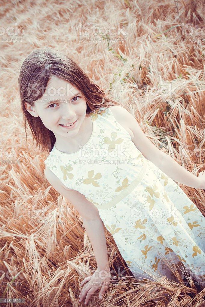 beautiful  girl in the field stock photo