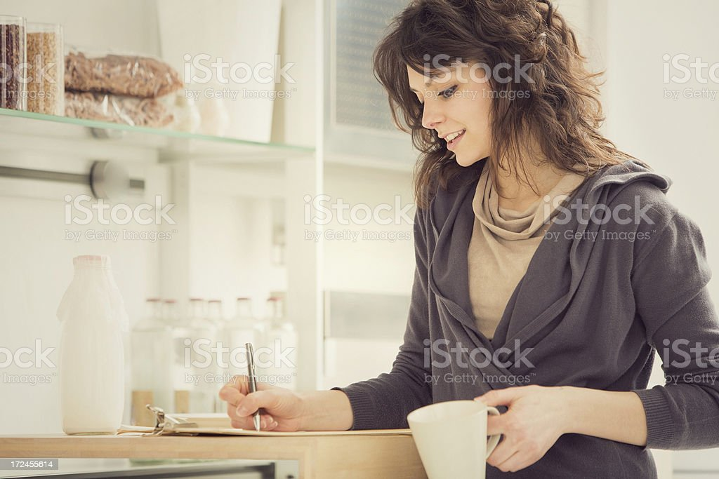 Beautiful girl in the kitchen portrait royalty-free stock photo