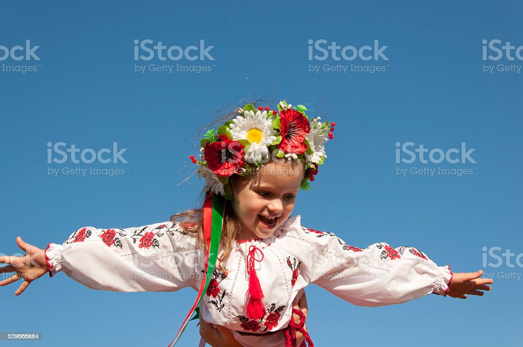 beautiful girl in traditional embroidered shirt jacket in the garden stock photo