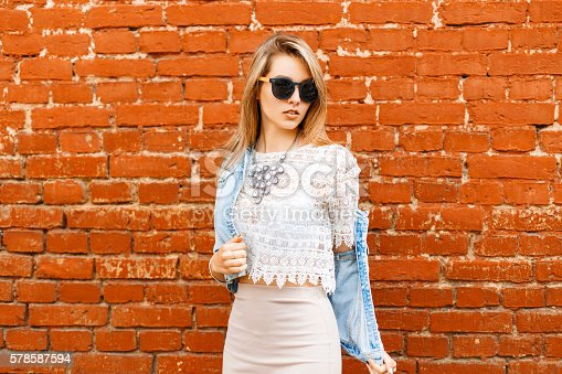 578791454istockphoto Beautiful girl in vintage lace blouse and sunglasses,  jacket. 578587594
