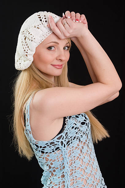 Beautiful girl in white beret and knitted jacket. stock photo