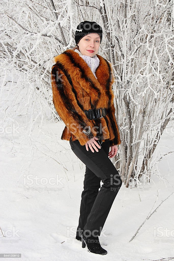Beautiful girl in winter forest. stock photo