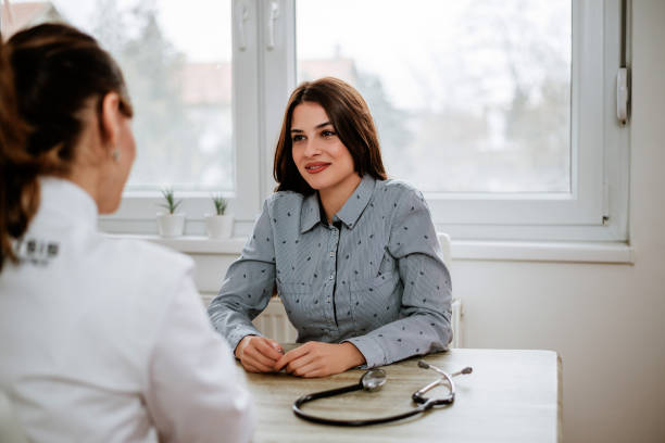 Beautiful girl is consulting with gynecologist Beautiful girl is consulting with gynecologist gynecological examination stock pictures, royalty-free photos & images