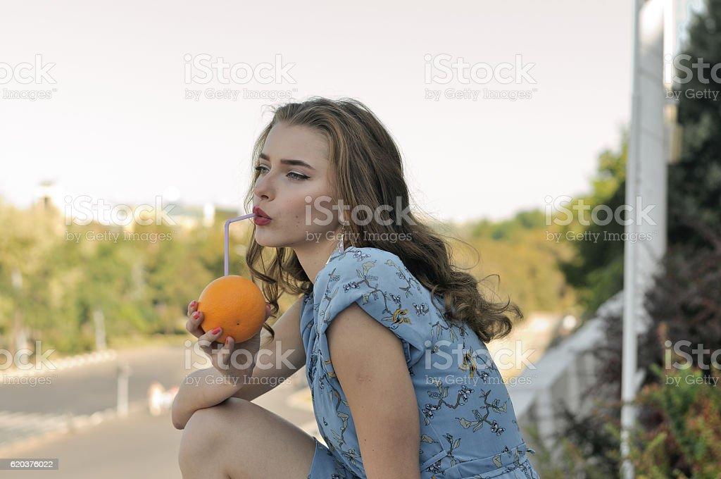 Beautiful girl is drinking juice foto de stock royalty-free