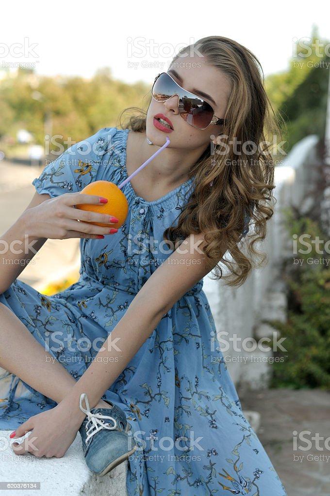 Beautiful girl is drinking juice zbiór zdjęć royalty-free