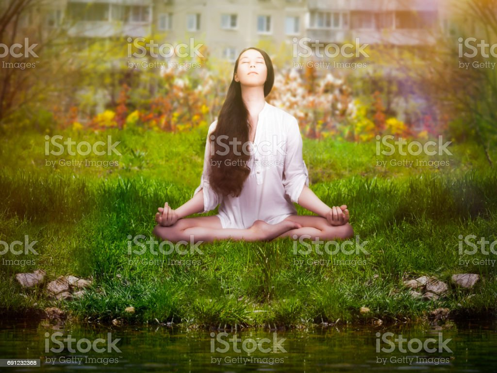 Beautiful Girl Is Engaged In Yoga Meditation On Nature In The City Park Stock Photo Download Image Now Istock