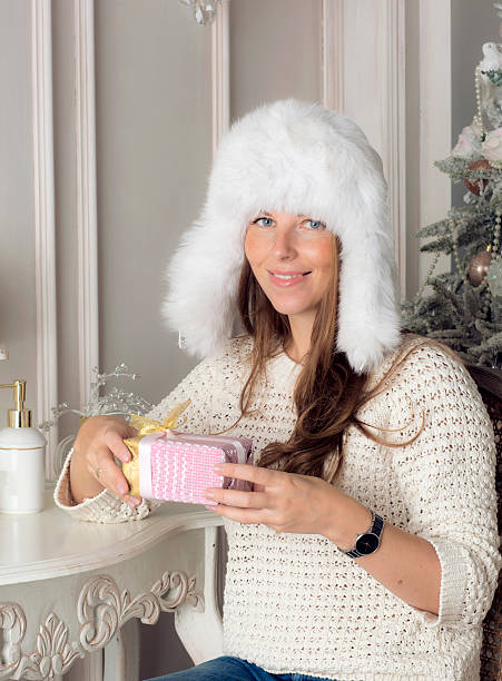 beautiful girl is holding a gift. - weihnachtsspende stock-fotos und bilder