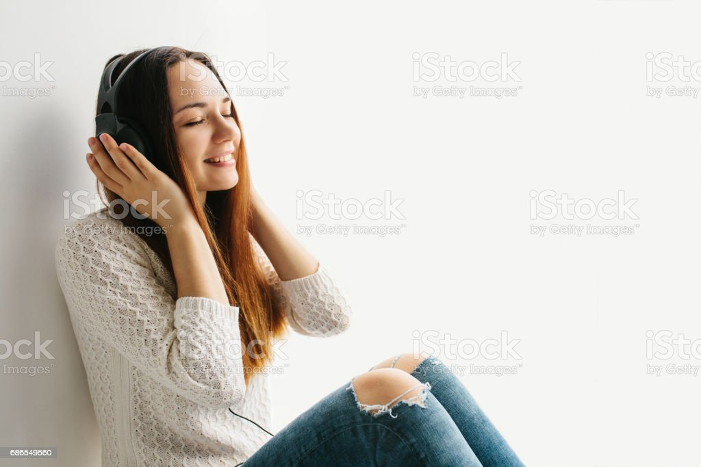 Beautiful girl is listening to the music royalty-free stock photo