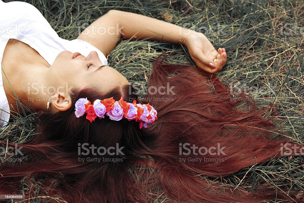 Beautiful girl is lying on the grass royalty-free stock photo
