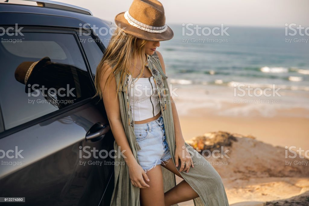 Beautiful girl leaning over the car stock photo
