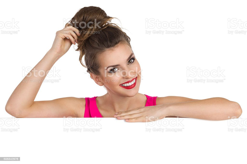 Beautiful Girl Leans On Placard stock photo