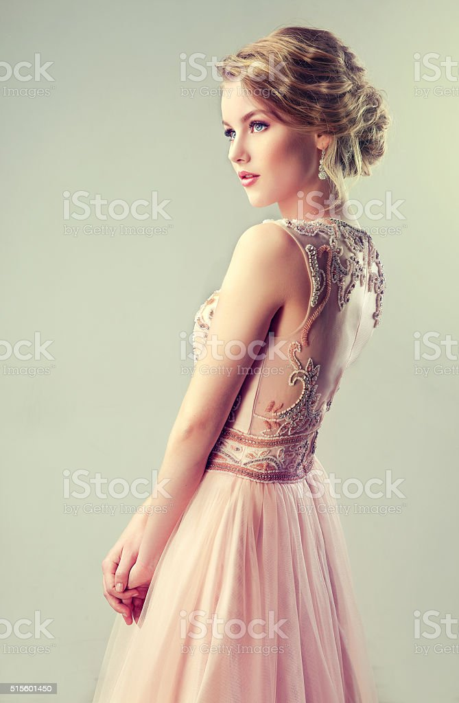 Beautiful girl light brown hair with an elegant hairstyle. stock photo