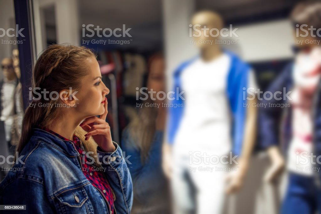 Beautiful Girl Looking At A Shop Window stock photo