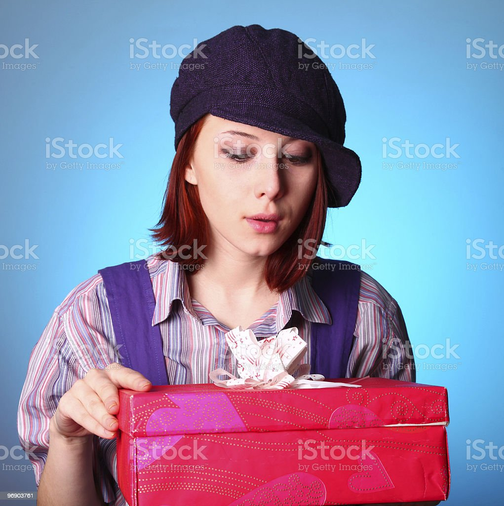 Beautiful girl looking at present in St. Valentine's Day royalty-free stock photo