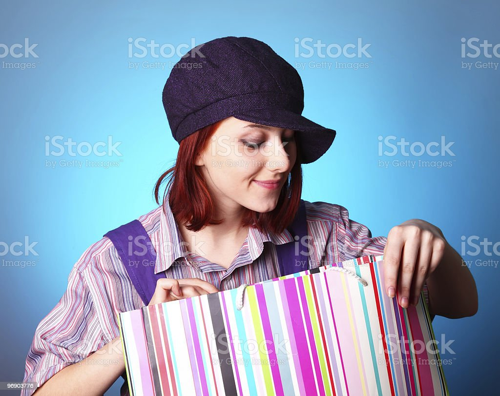 Beautiful girl looking in present box at St. Valentine's Day royalty-free stock photo