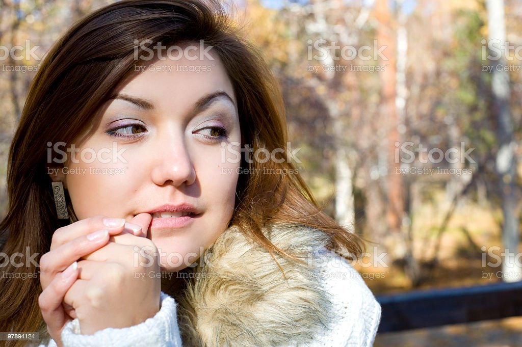 beautiful girl looks sideways royalty-free stock photo
