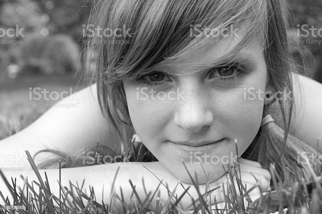 Beautiful Girl Lying in Grass royalty-free stock photo