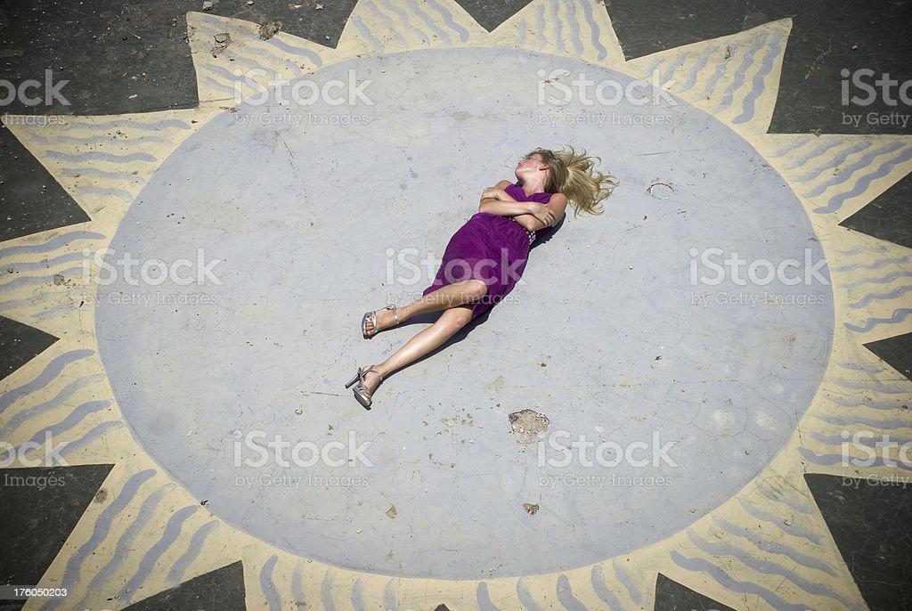 Beautiful girl lying on a floor stock photo