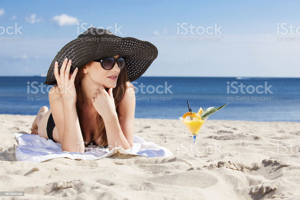Beautiful girl lying on the beach royalty-free stock photo