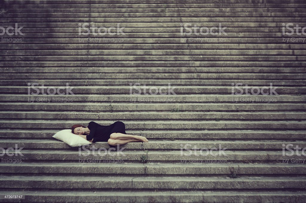 Beautiful girl lying on the stairs royalty-free stock photo