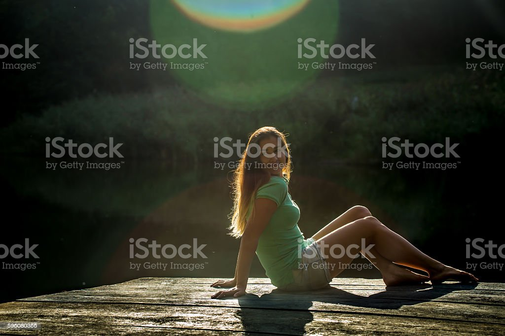 beautiful girl lying on wooden pier royalty-free stock photo