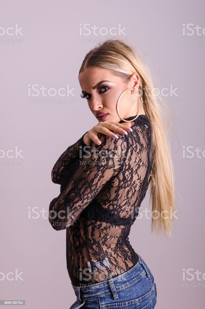 Beautiful girl model posing in the studio. Modern woman portrait stock photo