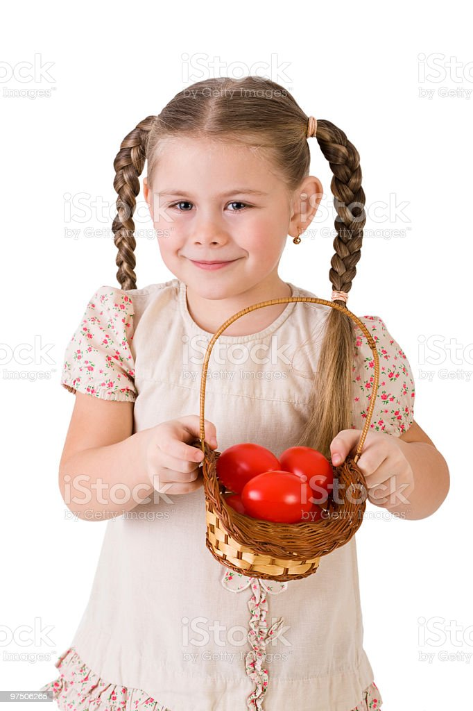 Beautiful girl offering  a basket with red easter eggs royalty-free stock photo