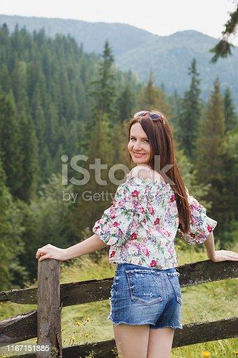istock Beautiful girl on a background of mountain landscape, Carpathians, Ukraine. 1167151885